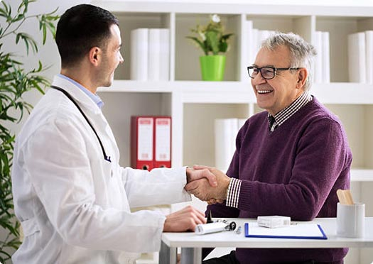 Image of a doctor meeting with an older patient.