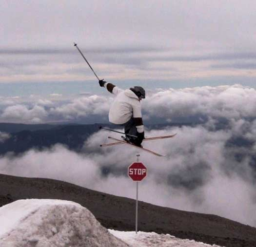 Image of Dr. Doerr performing a grab over a stop sign while skiing.